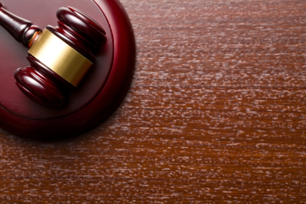 top view of judge gavel on wooden background